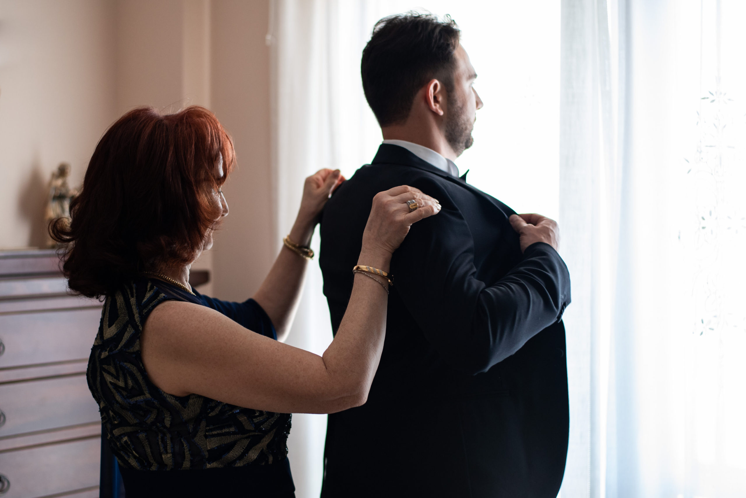 Groom Mother Helping With Jacket